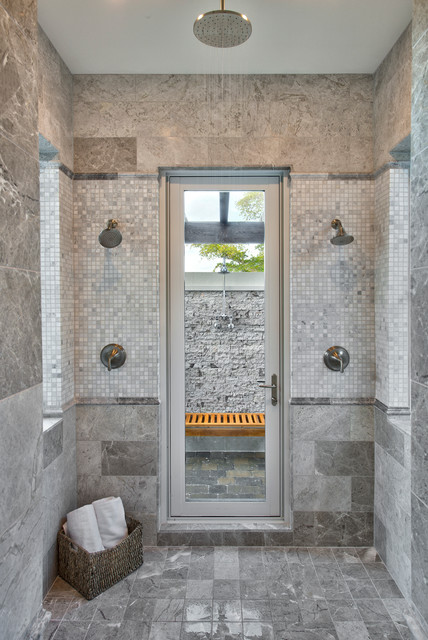 Example of a classic gray tile double shower design in Miami