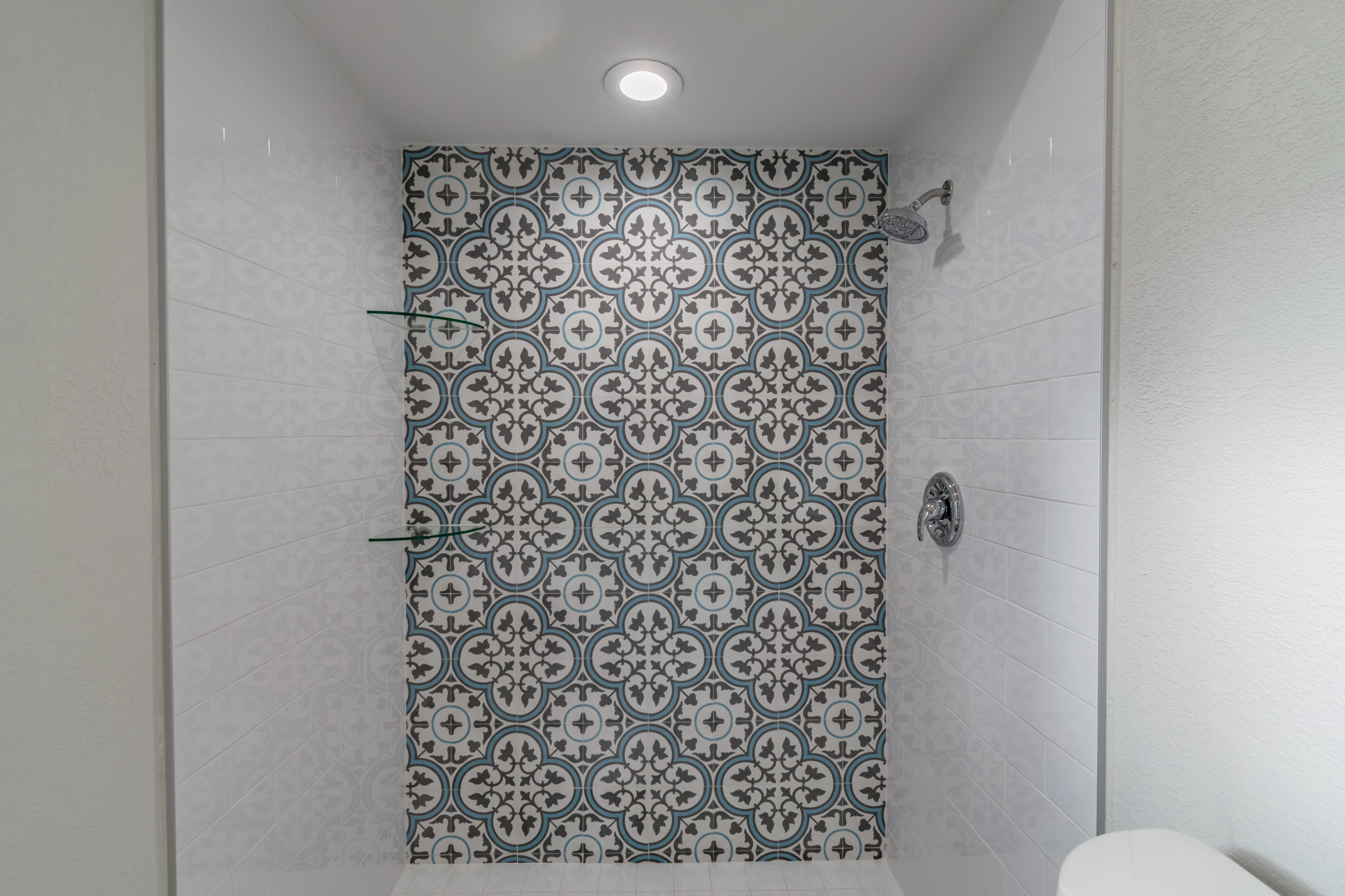 Master bath with cement tile feature wall