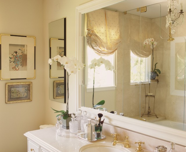 Master bath with Crema Marfil marble and mirrored silk window treatment traditional bathroom