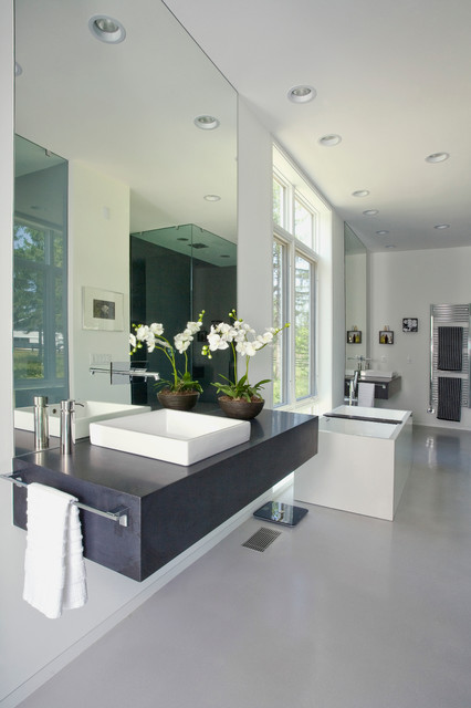 Master Bath With Floating Vanity And Free Standing Tub In Contemporary Europe