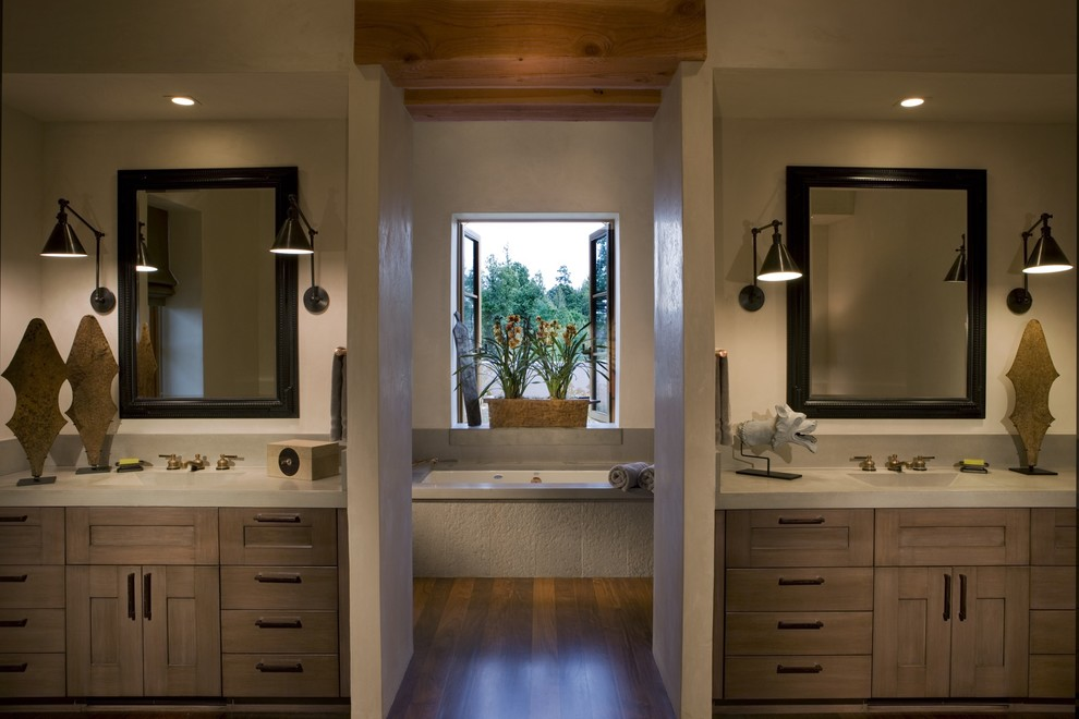Inspiration for a rustic bathroom remodel in San Francisco with concrete countertops