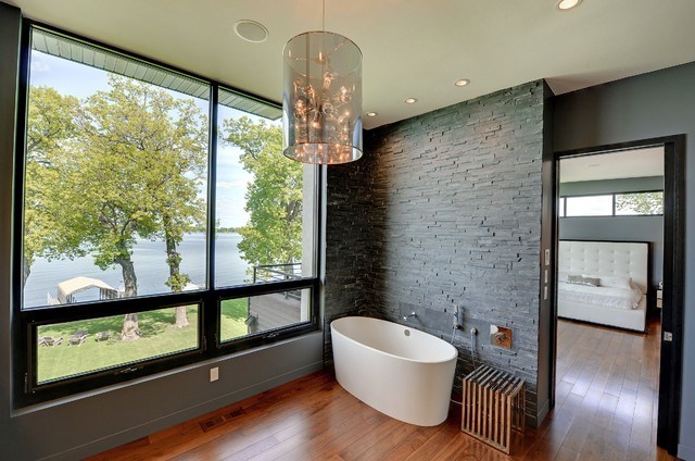 Master bath with lake view contemporary bathroom