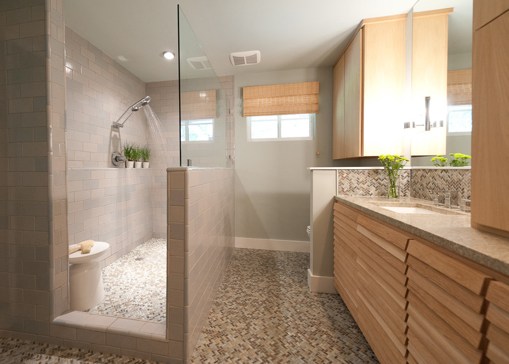 Inspiration for a contemporary beige tile and mosaic tile bathroom remodel in Austin with an undermount sink, louvered cabinets and light wood cabinets