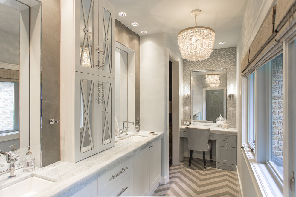 Inspiration for a large transitional master gray tile and porcelain tile porcelain floor bathroom remodel in Houston with an undermount sink, furniture-like cabinets, white cabinets, quartzite countertops, a wall-mount toilet and gray walls