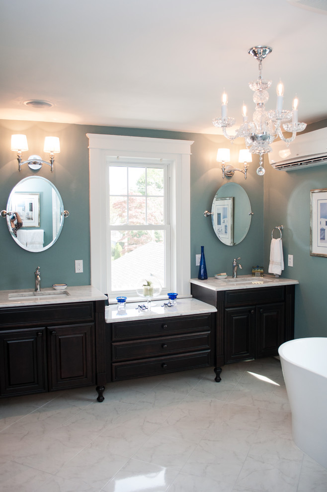 Inspiration for a large timeless master white tile porcelain tile bathroom remodel in Philadelphia with an undermount sink, furniture-like cabinets, dark wood cabinets, marble countertops, a two-piece toilet and blue walls