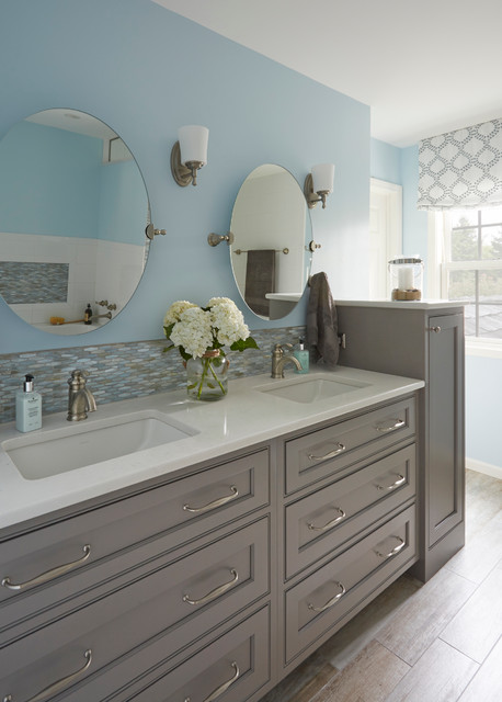 Inspiration for a mid-sized beach style master blue tile and porcelain tile porcelain floor doorless shower remodel in Chicago with an undermount sink, gray cabinets, solid surface countertops, a two-piece toilet, blue walls and recessed-panel cabinets