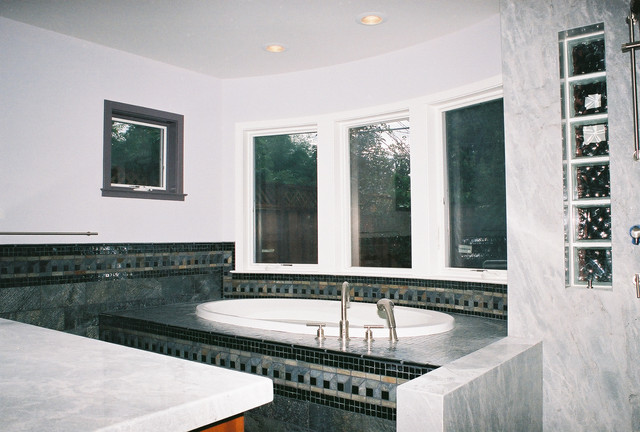 Master bathroom decorative tile surround on bow window for Decorative windows for bathrooms