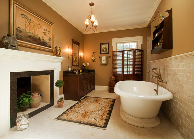 Freestanding bathtub - mid-sized traditional master beige tile and ceramic tile ceramic floor and beige floor freestanding bathtub idea in Chicago with shaker cabinets, dark wood cabinets, beige walls, an undermount sink and granite countertops