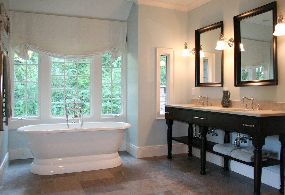 Inspiration for a timeless freestanding bathtub remodel in Atlanta with a console sink and marble countertops