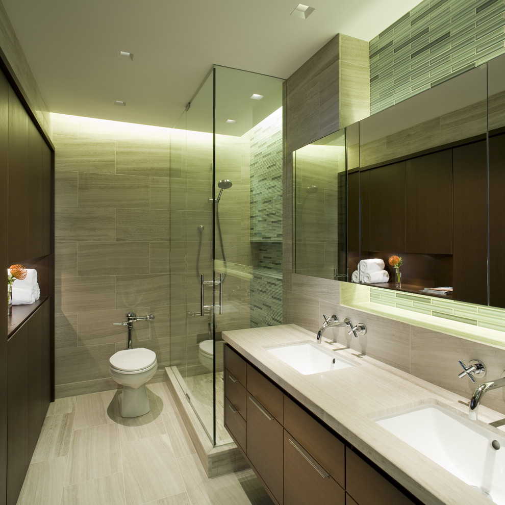 Trendy master gray tile corner shower photo in Chicago with an undermount sink, flat-panel cabinets, dark wood cabinets, a one-piece toilet and gray walls