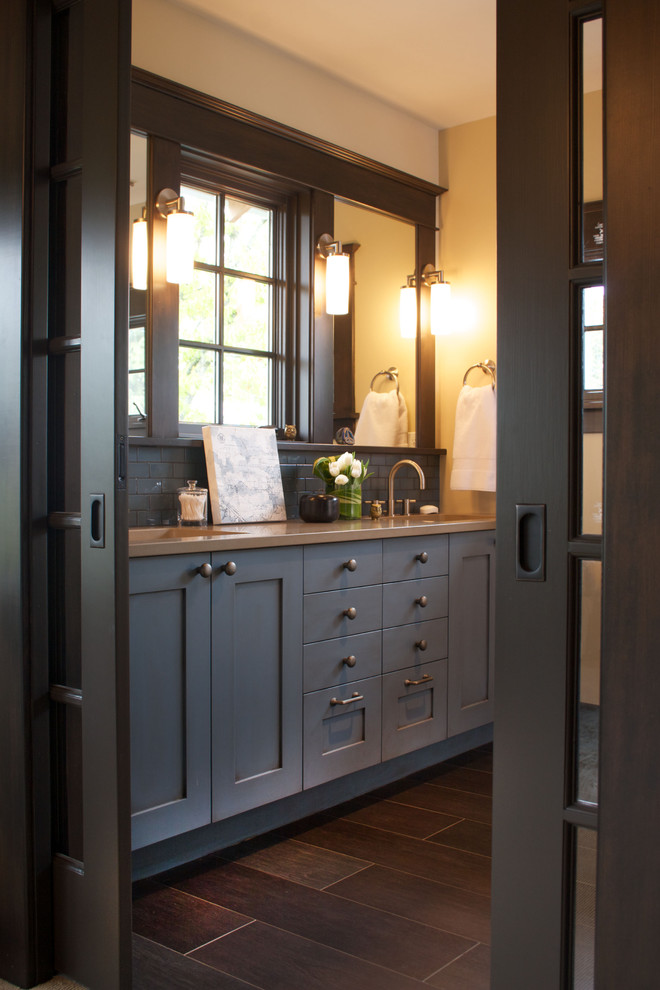 Elegant gray tile bathroom photo in Portland with an undermount sink, shaker cabinets and black cabinets