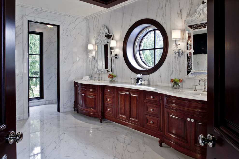 Bathroom - traditional white tile and marble tile marble floor bathroom idea in Detroit with an undermount sink, dark wood cabinets and raised-panel cabinets
