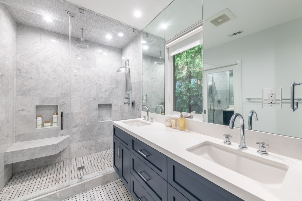 Inspiration for a large transitional master gray tile and porcelain tile marble floor, double-sink and gray floor bathroom remodel in Los Angeles with shaker cabinets, blue cabinets, a one-piece toilet, white walls, an undermount sink, quartz countertops, a hinged shower door, white countertops and a floating vanity