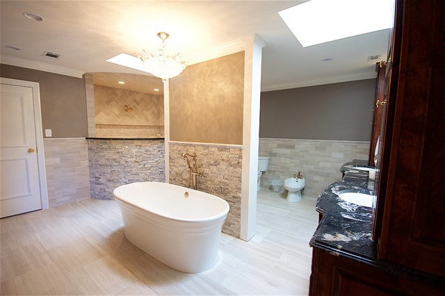 Inspiration for a large contemporary master beige tile ceramic floor bathroom remodel in Austin with beaded inset cabinets, dark wood cabinets, a bidet, beige walls, a drop-in sink and granite countertops