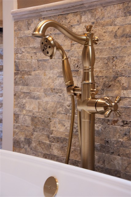 Example of a large trendy master beige tile ceramic floor bathroom design in Austin with beaded inset cabinets, dark wood cabinets, a bidet, beige walls, a drop-in sink and granite countertops