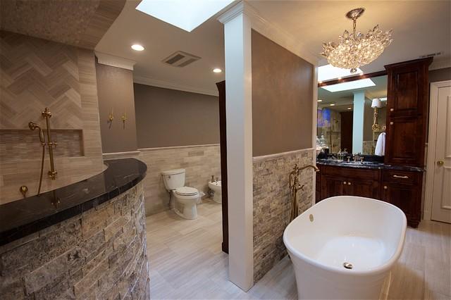 Large trendy master beige tile vinyl floor and beige floor bathroom photo in Austin with beaded inset cabinets, dark wood cabinets, a bidet, beige walls, a drop-in sink and granite countertops