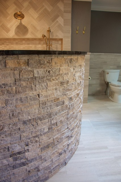Large trendy master beige tile ceramic floor bathroom photo in Austin with beaded inset cabinets, dark wood cabinets, a bidet, beige walls, a drop-in sink and granite countertops