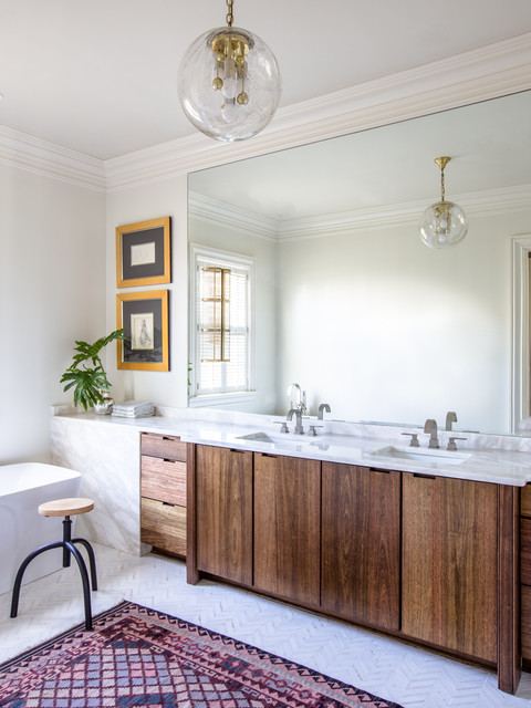 Example of a large transitional master white tile and stone slab marble floor freestanding bathtub design in New Orleans with flat-panel cabinets, dark wood cabinets, white walls, an undermount sink and marble countertops