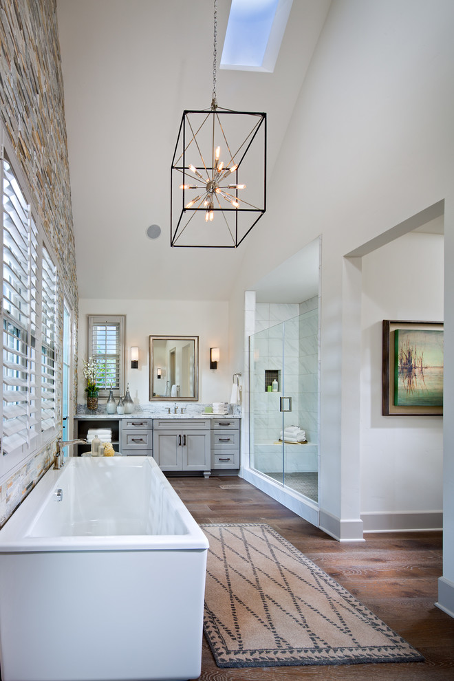 Large transitional master medium tone wood floor bathroom photo in San Diego with recessed-panel cabinets, gray cabinets, white walls, marble countertops and a hinged shower door