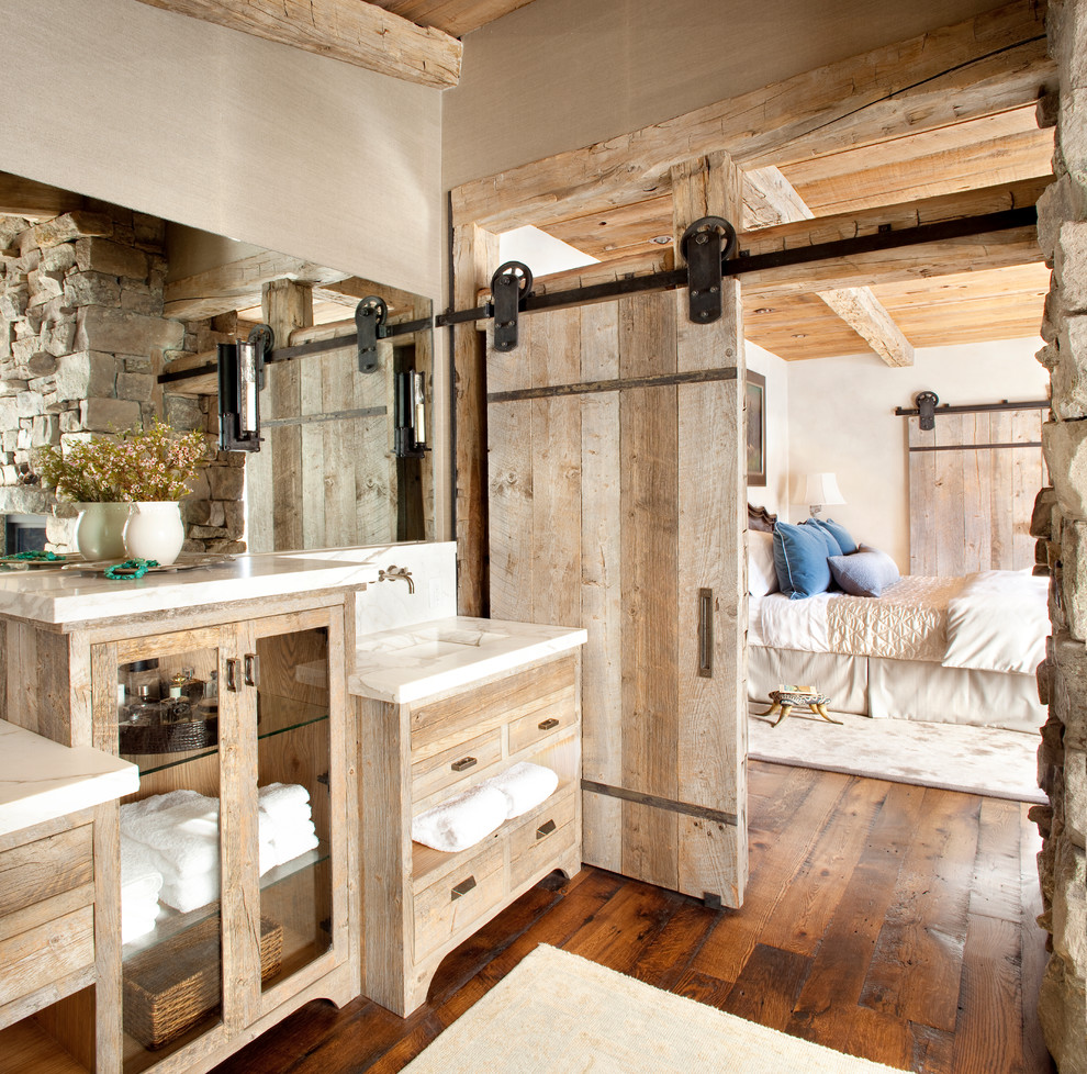 Inspiration for a rustic medium tone wood floor bathroom remodel in Atlanta with an integrated sink, distressed cabinets, flat-panel cabinets and marble countertops