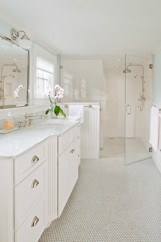 Example of a trendy mosaic tile floor walk-in shower design in Boston with marble countertops and white cabinets