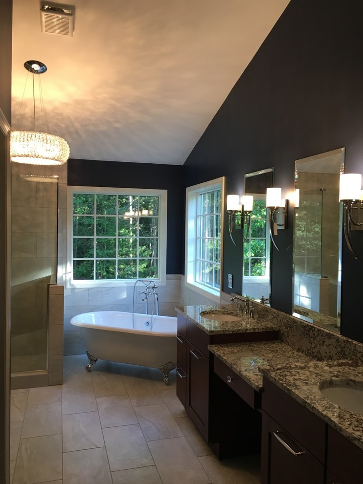 Bathroom - large transitional master beige tile and ceramic tile beige floor and ceramic tile bathroom idea in New York with shaker cabinets, dark wood cabinets, an undermount sink, granite countertops, a hinged shower door and blue walls