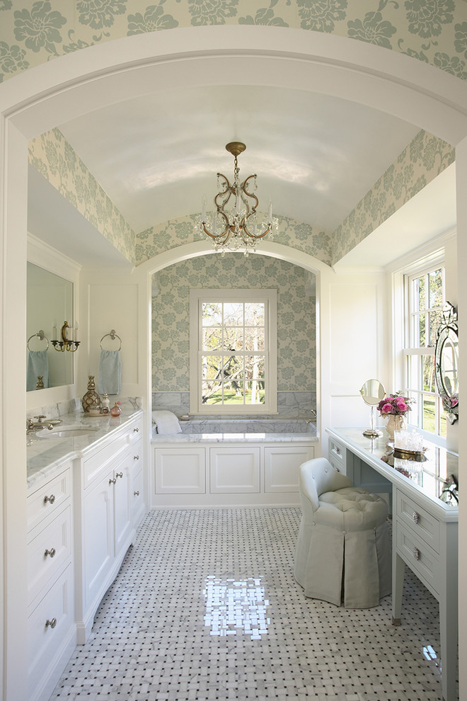Inspiration for a large timeless master marble floor alcove bathtub remodel in Minneapolis with marble countertops, shaker cabinets, white cabinets, white walls, an undermount sink and gray countertops