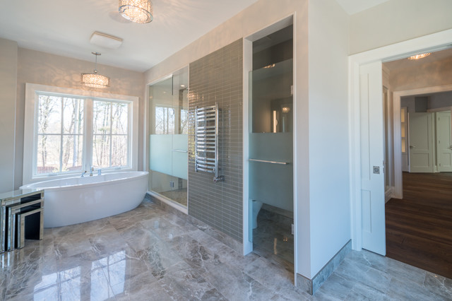 Example of a large trendy master gray tile and porcelain tile porcelain floor bathroom design in Toronto with an undermount sink, shaker cabinets, white cabinets, solid surface countertops, a one-piece toilet and gray walls