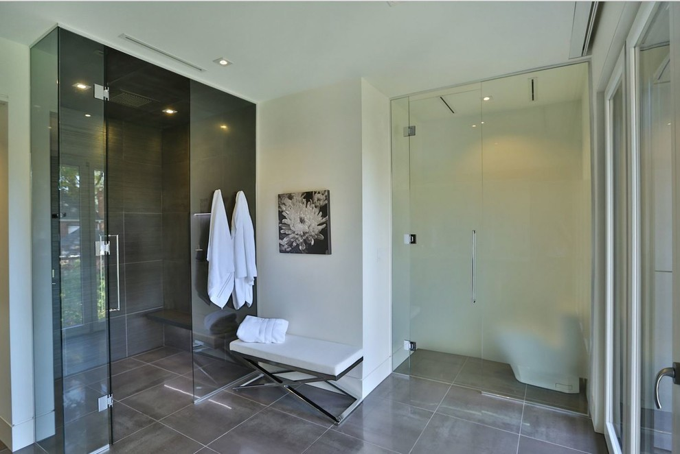 Example of a large trendy master gray tile porcelain tile walk-in shower design in Toronto with flat-panel cabinets, gray cabinets, white walls, an undermount sink and quartz countertops