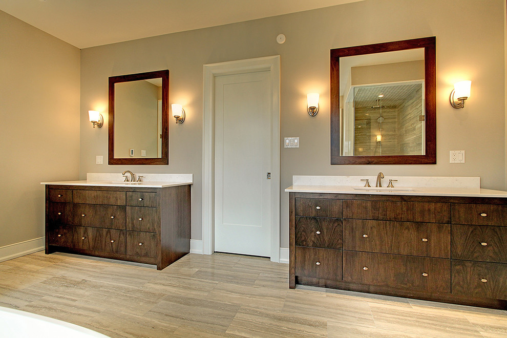 Example of a mid-sized transitional master porcelain tile bathroom design in Toronto with flat-panel cabinets, dark wood cabinets, gray walls and an undermount sink