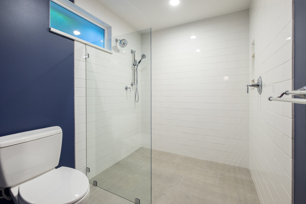 Mid-sized elegant master white tile and ceramic tile porcelain tile bathroom photo in Portland with recessed-panel cabinets, white cabinets, a two-piece toilet, blue walls, an undermount sink and quartz countertops