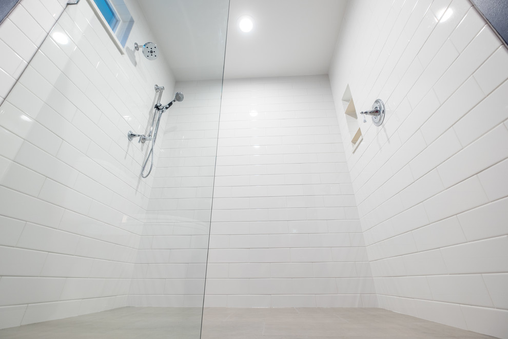 Inspiration for a mid-sized timeless master white tile and ceramic tile porcelain tile bathroom remodel in Portland with recessed-panel cabinets, white cabinets, a two-piece toilet, blue walls, an undermount sink and quartz countertops