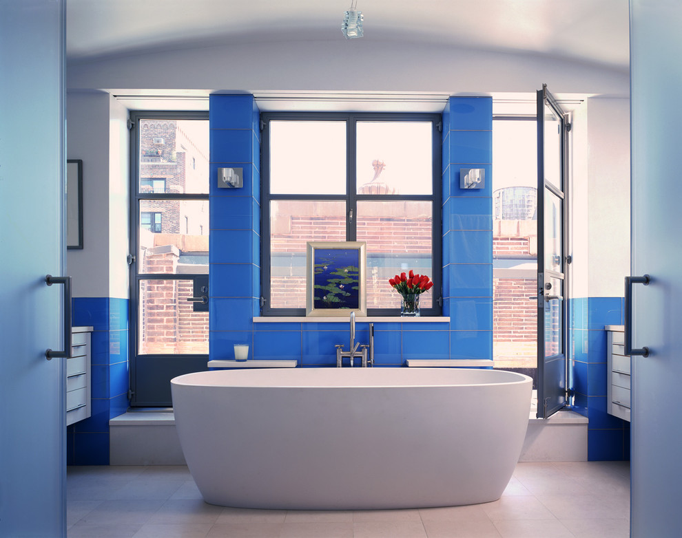 Example of a trendy glass tile and blue tile bathroom design in New York