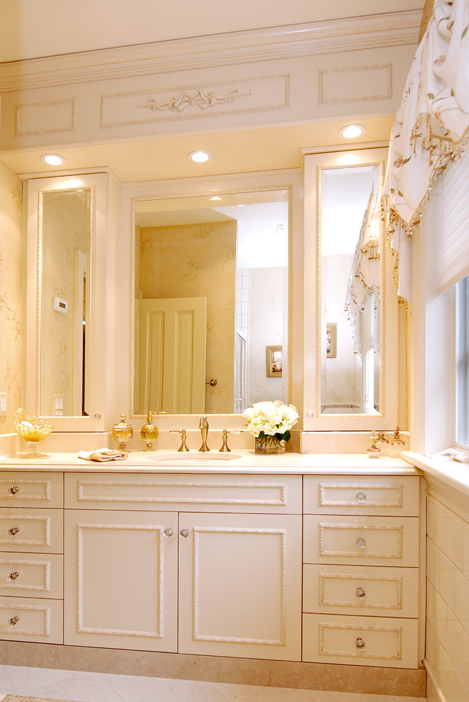 Large elegant master beige tile ceramic tile bathroom photo in New York with white cabinets, raised-panel cabinets, white walls and an undermount sink
