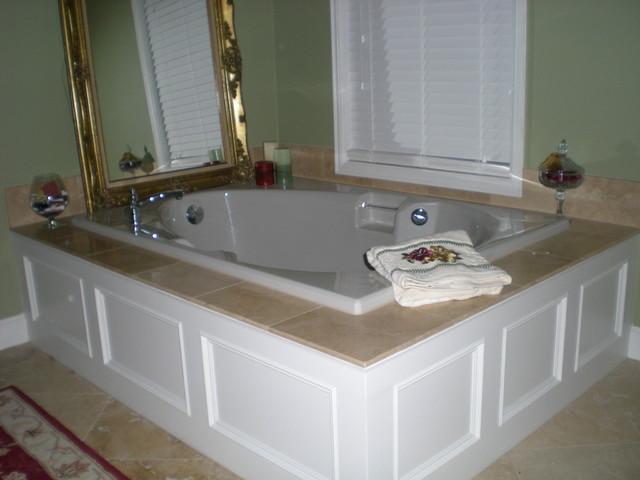 Master bathroom tub panel moulding with travertine tile for Master bathroom tub ideas