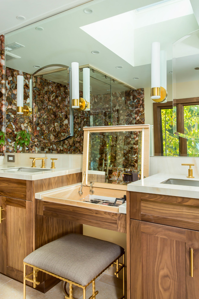 Huge trendy master multicolored tile and stone slab marble floor and beige floor bathroom photo in Los Angeles with shaker cabinets, medium tone wood cabinets, a wall-mount toilet, beige walls, an undermount sink, solid surface countertops and a hinged shower door