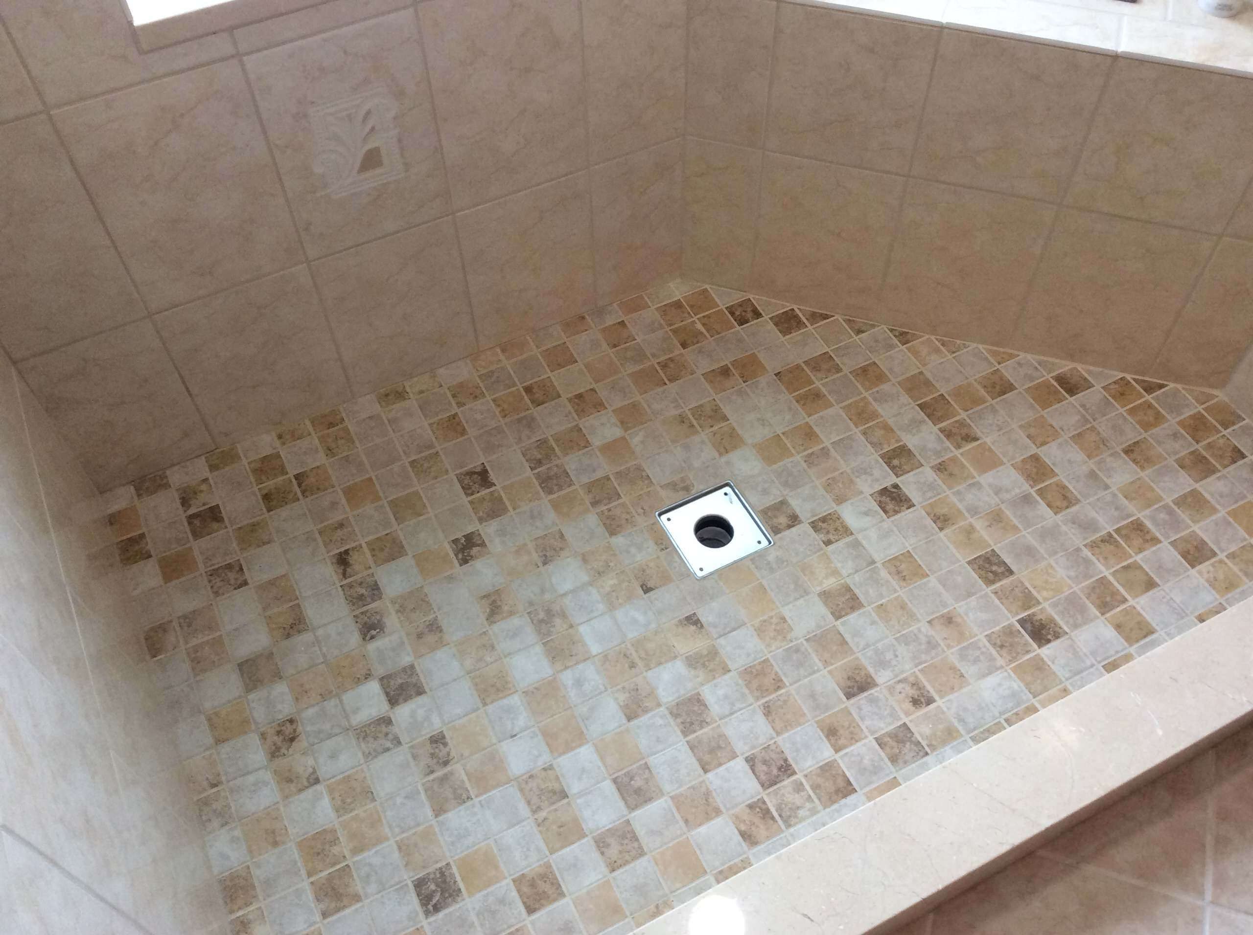 Master Bathroom Walk-in Shower with Triangle Seat