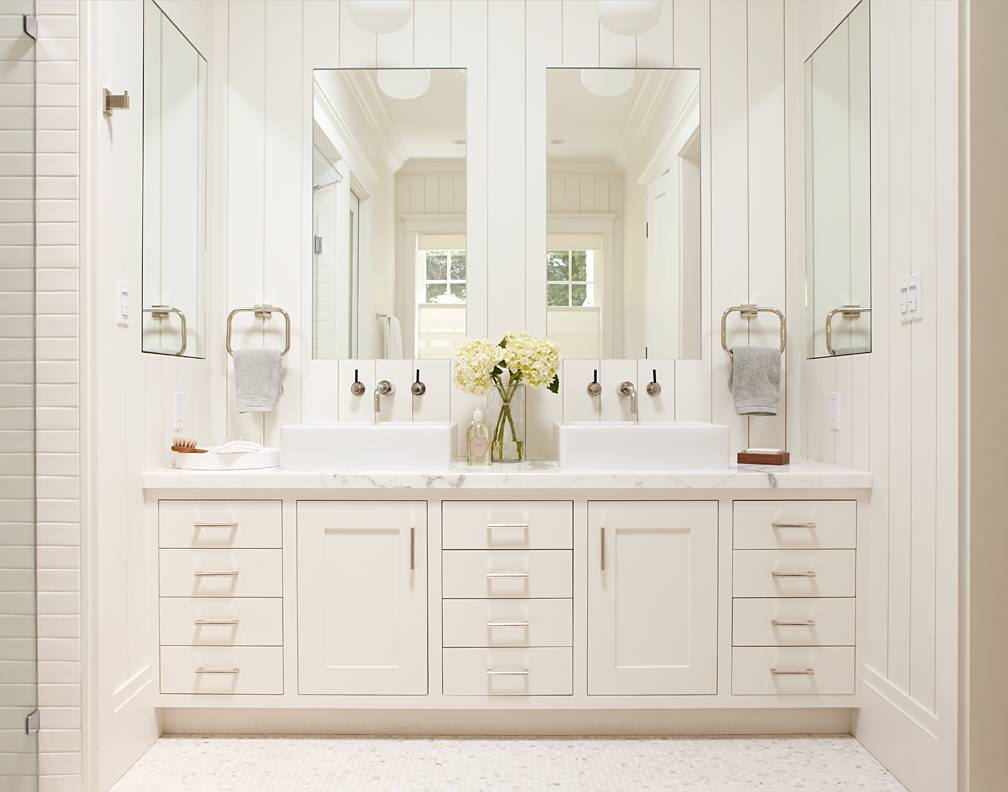 Master bathroom, white vanity with two sinks and large mirrors