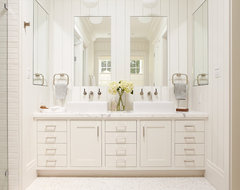 Master bathroom, white vanity with two sinks and large mirrors traditional bathroom