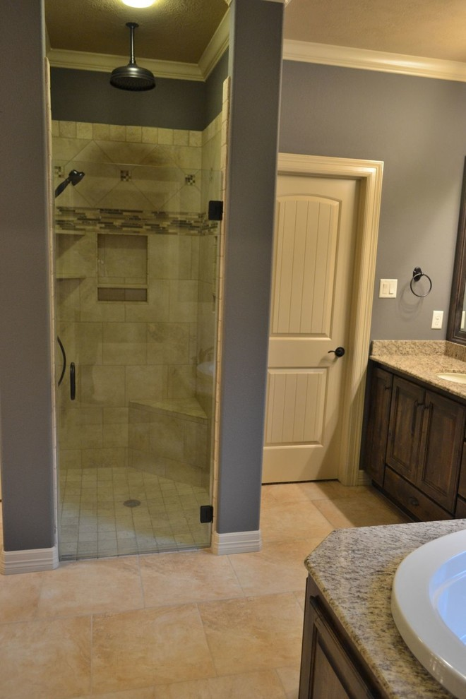 Master bathroom with dark gray walls, light tile, stained ...