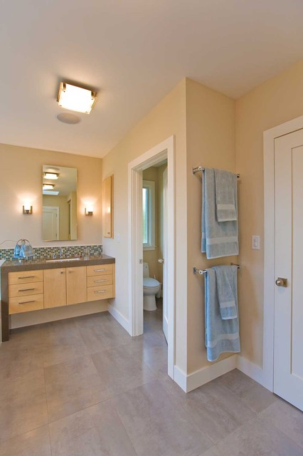 master bathroom with separate room for toilet