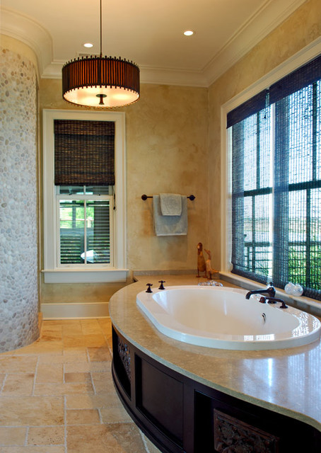 Master bathtub with large windows on view tropical bathroom