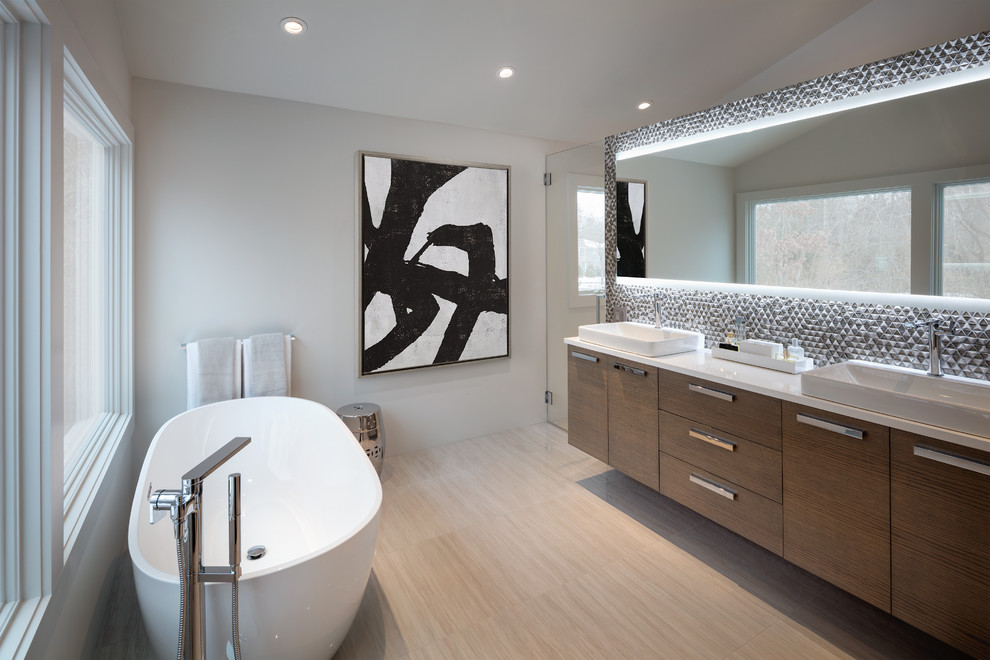 Inspiration for a contemporary master gray tile beige floor bathroom remodel in New York with flat-panel cabinets, medium tone wood cabinets, white walls, a vessel sink and a hinged shower door