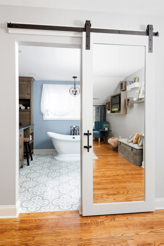 Inspiration for a large transitional master porcelain tile and multicolored floor bathroom remodel in Other with shaker cabinets, medium tone wood cabinets, blue walls, a vessel sink, marble countertops, a hinged shower door and blue countertops