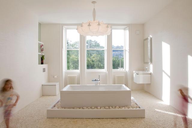 inspiration for a large modern master white tile and ceramic tile pebble tile floor bathroom remodel