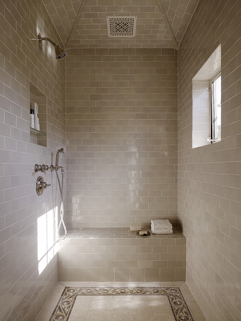 Tuscan beige tile and subway tile bathroom photo in San Francisco