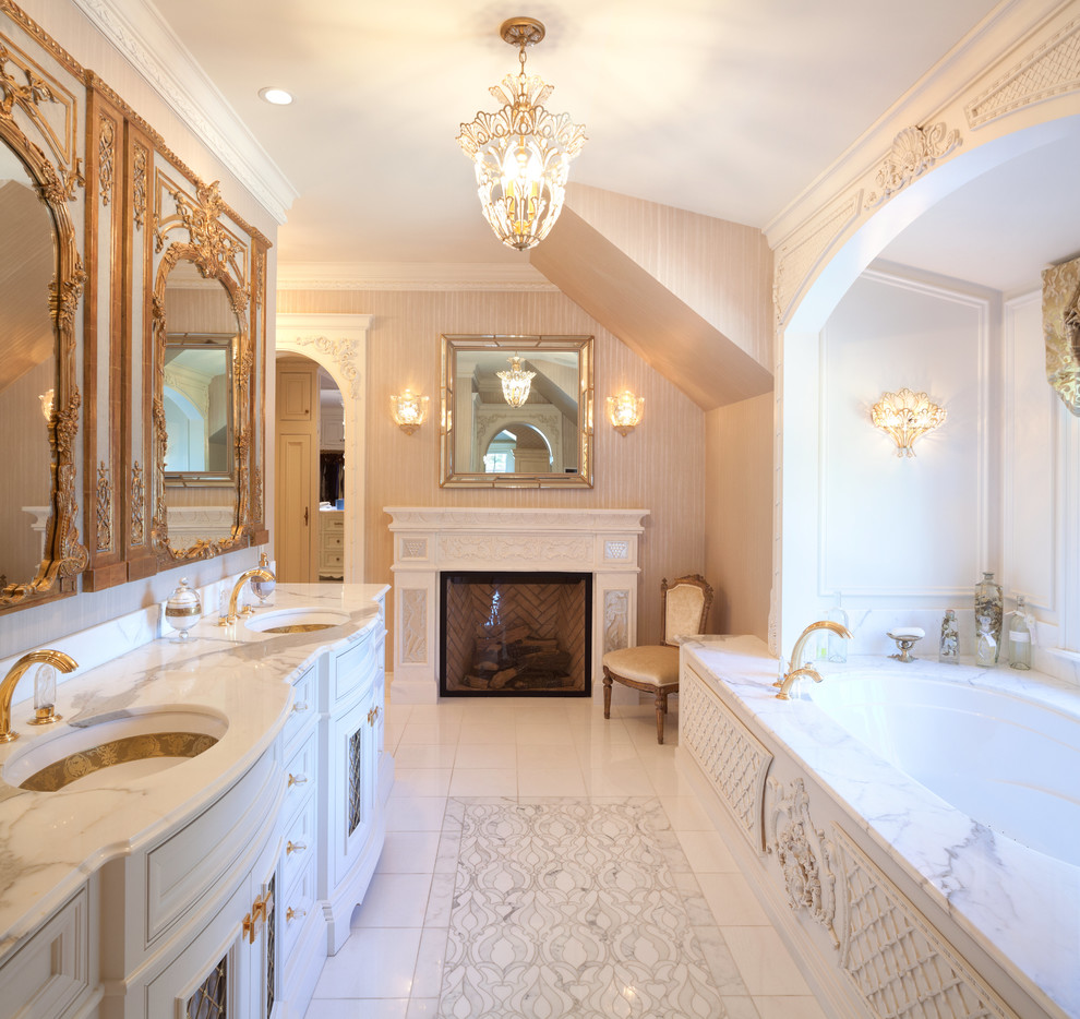 Elegant master bathroom photo in Minneapolis with furniture-like cabinets, an undermount tub, beige walls and an undermount sink