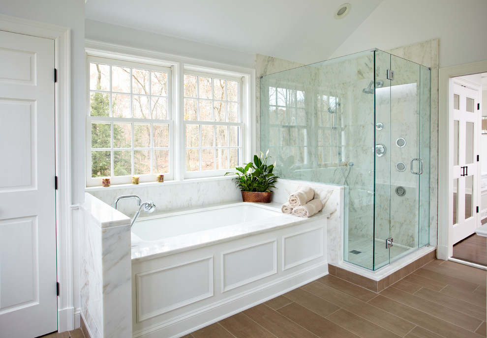 Alcove shower - traditional alcove shower idea in New York with an undermount tub