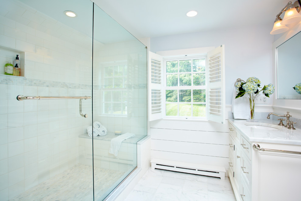 Elegant alcove shower photo in New York with an undermount sink, recessed-panel cabinets and white cabinets