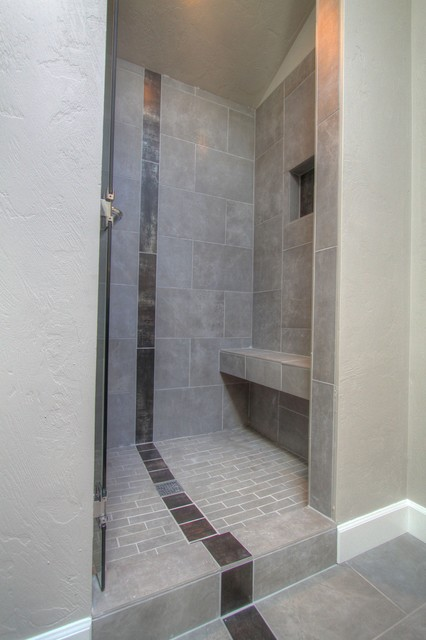 Master Suite Tiled Shower With Accent Stripe Bench